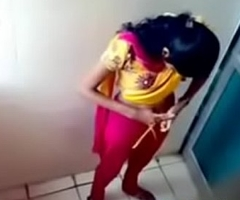 Hidden cam in ladies bathroom skirt pissing